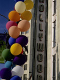 Multi-Colored Balloons and a Neon Sign Welcome Visitors to Hollywood Photographic Print by Stephen St. John