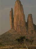 Five Spires, Dubbed the Hand of Fatima, Jut out of the Flat Desert Photographic Print by Bobby Model