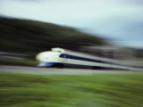 A Blurred View of a Bullet Train Fotografisk tryk af Paul Chesley