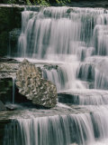 A Time Exposure Captures the Waters Motion as it Falls over Sculpted Rocks Photographic Print by Skip Brown