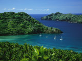 Sailboats Anchored in a Cove of Blue Water on an Asian Island Photographic Print by Tim Laman