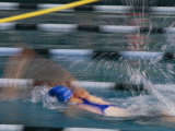 A Swimmer Races Through the Water at a Swimming Competition Photographic Print by Michael S. Lewis