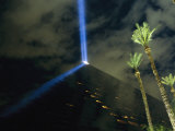 The Top of the Luxor Hotel Pyramid Projects Holograms onto a Fountain Nightly Photographic Print by Maria Stenzel