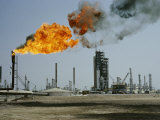 A Flame Spurts from an Oil Refinery in Saudi Arabia Photographic Print by W. Robert Moore