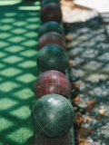 Wooden Balls That are Bowled in the Italian Game of Bocce Fotografisk tryk af Gina Martin