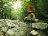 Panned View of Man Leaping over Rocky Stream on the Appalachian Trail Fotoprint van Skip Brown