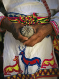 A Traditionally Dressed Huichol Man Holds a Hikuli Plant, or Peyote Photographic Print by Maria Stenzel