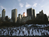 Elevated View of Ice Skaters in Central Park and of the Surrounding Cityscape Photographic Print by Ira Block