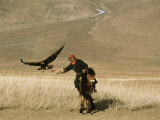 A Kazakh Falconer Hunts with His Golden Eagle Photographic Print by David Edwards