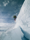A Skier Leaps a Large Crevasse in Calley Glacier Photographic Print by Gordon Wiltsie