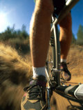 A Close View Photo of a Mountain Bikers Pedals as He Whizzes by on the Dirt Trail Photographic Print by Barry Tessman