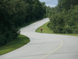 A Cyclist on a Scenic Drive in Gatineau Park Fotoprint van Michael S. Lewis