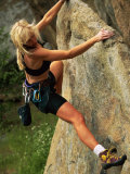 A Woman Begins Her Rock Climbing Journey Photographic Print by Barry Tessman