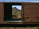 A View of a Distant Hill Through the Door of a Railway Car Photographic Print by Tim Laman
