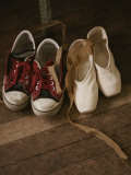 A Pair of Ballet Toe Shoes Rest Next to a Pair of Tennis Shoes Photographic Print by Jodi Cobb