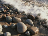 A Close View Time Exposure of Surf Washing over Stones on the Beach Photographic Print by Michael S. Lewis