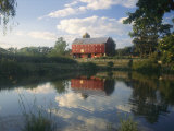 An Old Red Barn Reflected in a Pond Photographic Print by Richard Nowitz