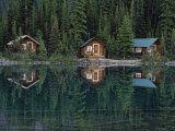 Lake Ohara Lodge Cabins Reflected on the Surface of Lake Ohara Photographic Print by Michael Melford