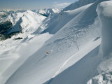 A Man Skiing the Dogtooth Range Photographic Print by Tim Laman