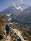 A Hiker Treks Toward Mount Ama Dablam Photographic Print by Michael Klesius