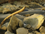 Rock Creek Rushes Past Large Boulders and Driftwood at Sunset Photographic Print by Raymond Gehman