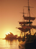 Sydney Opera House and the Hms Bounty, a Replica of the Famous Ship, Silhouetted by the Setting Sun Photographic Print by Richard Nowitz