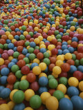 A Rainbow-Colored Landslide of Toy Balls in Abstract Patterns Photographic Print by Stephen St. John