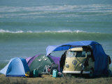Campsite on Oceans Edge with Tents, Vw Camper and Surfer in a Chair Photographie par Skip Brown