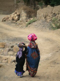 A Yemeni Woman and Child Carrying Bundles on Their Heads Photographic Print by Michael Melford