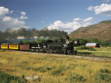 Old Locomotive with Billowing Black Smoke in Hilly Countryside Photographic Print by Richard Nowitz