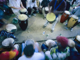 The Blur of a Frenzied Beat in a Circle of Spontaneous Drumming Fotografisk tryk af Stephen St. John