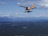 A Cessna Plane Flies over Backcountry Air Lanes Near the Alaska Range Photographic Print by Ira Block