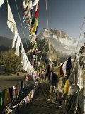 Prayer flags wave outside The Potala, former abode of the Dalai Lama, Photographic Print