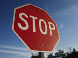 A Red Stop Sign against a Blue Sky Photographic Print by Stephen St. John