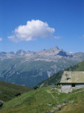 A Cow Herder's Mountain Hut High in the Swiss Alps Impressão fotográfica por Taylor S. Kennedy