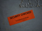 A Security Sticker is Attached to a Piece of Baggage Photographie par Stephen Alvarez