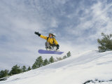 Woman Snowboarding on the Cinder Cone near Sunset Crater Photographic Print by Kate Thompson