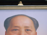 A Person Stands on a Balcony over a Giant Poster of Mao Tse-Tung Photographic Print by Jodi Cobb