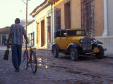 A Man Walks Down the Cobblestoned Street of This Tropical Island, Trinidad, Cuba Photographic Print by Taylor S. Kennedy
