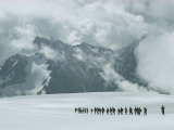 Hikers on a Snowfield Near Mount Elbrus Photographic Print by Dean Conger
