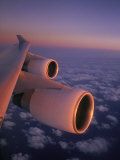 A Close View of the Wing and Jet Engines of a Plane in Flight Photographie par Paul Chesley