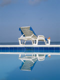 A Deck Chair Offers Poolside Relaxation to a Vacationer Photographic Print by Michael S. Lewis