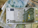 5-Euro Bill on Top of a Stack of Obsolete European Paper Money Photographic Print by Stephen Alvarez