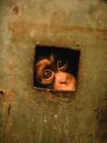 A Young Chimpanzee Held Captive in a Private Zoo in Monrovia Photographic Print by Michael Nichols