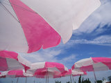 An Arrangement of Pink and White Beach Umbrellas at the Beach Photographic Print by Clarita Berger