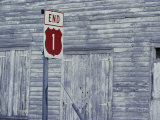 An Old Barn of Weathered Wood and a Road Sign Photographic Print by Medford Taylor