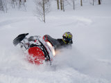 A Snowmobiler Spins Through Deep Powder Impresso fotogrfica por Taylor S. Kennedy