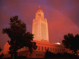A Rainbow Shines Over the Nebraska State Capitol after a Storm Photographic Print by Joel Sartore