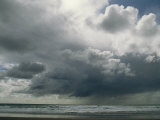 Dramatic Storm Clouds over Ocean Water Photographic Print by Charles Kogod