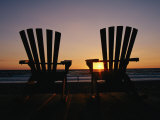 Two Chairs on a Shoreline Facing the Setting Sun Photographic Print by Steve Winter